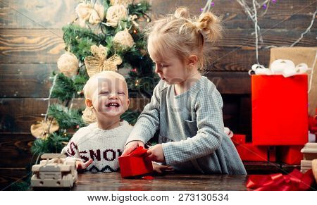 Cute Little Child Near Christmas Tree. Cheerful Cute Child Opening A Christmas Present. Christmas Ki