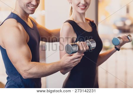 Happy Girl Doing Strength Exercise Dumbbell Hands. The Trainer Controls The Training The Woman Who P