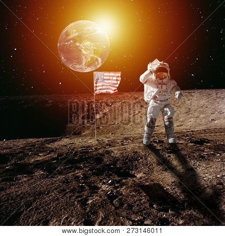Asteronaut Walking On Moon And Usa Flag. Blue Planet Earth And The Sun. Elements Of This Image Furni