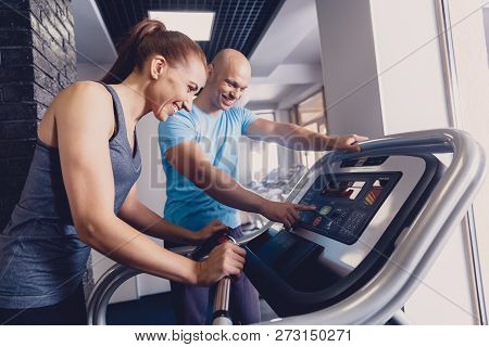 Personal Training With A Trainer On A Treadmill. The Trainer Controls The Correctness Of The Exercis