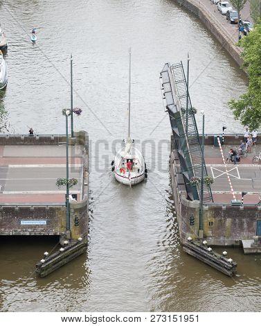 Leeuwarden, The Netherlands, 10 June 2018: Open Bridge In The Dutch Waterways During The Tourist Sea