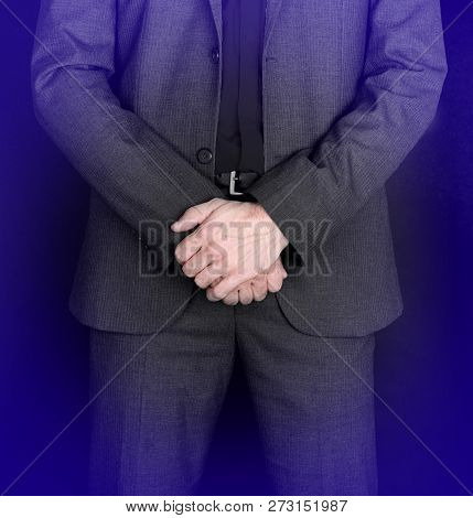 Businessman Standing With Hands Folded - Grey Suit
