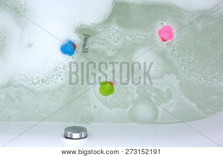 Pink, Green And Blue Duck In A Bathtub