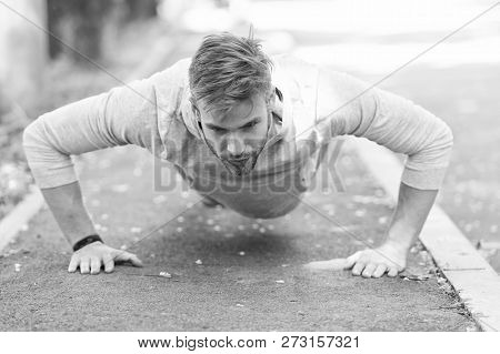 Strength And Motivation. Man In Sportswear Doing Push Ups Outdoor. Guy Motivated Workout In Park. Sp