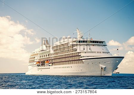 Cruise Ship. Large Luxury White Cruise Ship Liner On Sea Water And Cloudy Sky Background. Ship. Luxu
