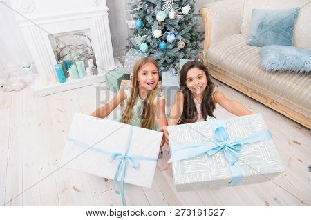 Everyone Will Get A Present. Delivery Christmas Gifts. Family Holiday. Happy Little Girls Sisters Ce