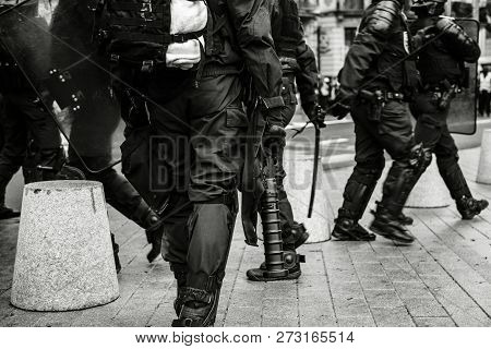 Rear View Of Police Officers Securing The Zone In Front Of The Yellow Vests Movement Protesters On Q