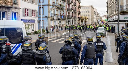 Strasbourg, France - Dec 8, 2018: Police Officers Securing The Zone In Front Of The Yellow Vests Mov