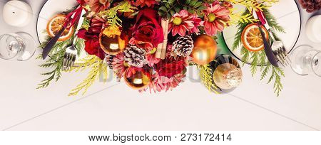 Christmas Table Setting. Border Of Flowers, Conifers And Dishes.