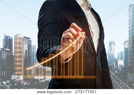 Businessman Drawing Increasing Digital Charts On Virtual Screen. Business Concept