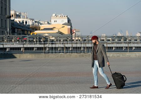 Adjust Living In New City. Carry Travel Bag. Man Bearded Hipster Travel With Luggage Bag On Wheels.
