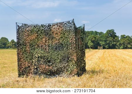 Camouflage Tent In Dutch Grain Field For Hunters Or Animal Spotters