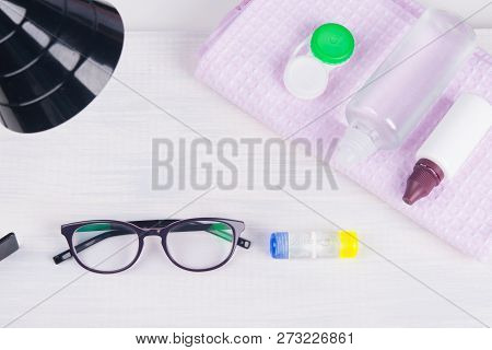 On The Table, There Are Items To Improve Vision, Glasses And Containers, Waiting For Improvement Of