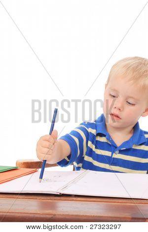 Little boy at a desk doing homework