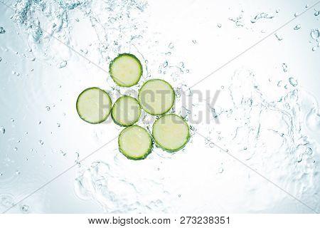 Freeze Motion Kiwi Water Splash On White Backgroundzucchini Water Splash On White Background
