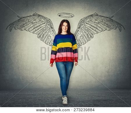 Casual Young Woman Full Length Portrait Imagining Her As A Superhero With Angel Wings And Halo Above