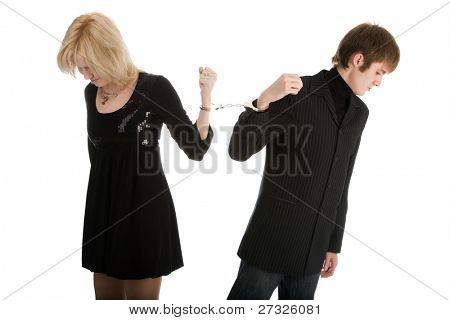 couple of young people with handcuffs isolated