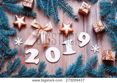New Year 2019 background with 2019 figures, Christmas toys, blue fir tree branches and snowflakes. New Year 2019 colorful festive design