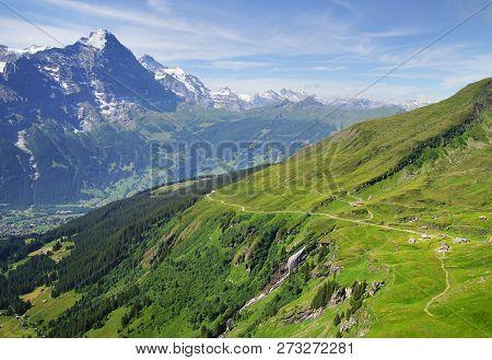 Alpine Peaks Of Grindelwald And Jungfrau. Landskape Background Of Bernese Highland. Alps, Tourism, J