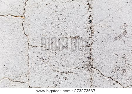 Close Up Details Of Old Stone Wall Surface With Bumps And Cracks.