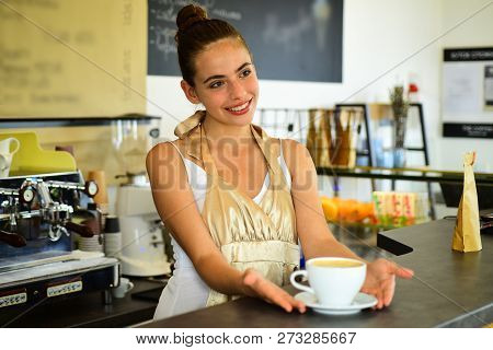 Todays Good Mood Is Sponsored By Coffee. Woman Barista In Coffee Shop. Barista Serve Cup Of Hot Coff