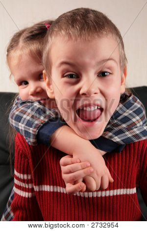 Girl Embraces Boy For The Neck Aggressive Defence Boy