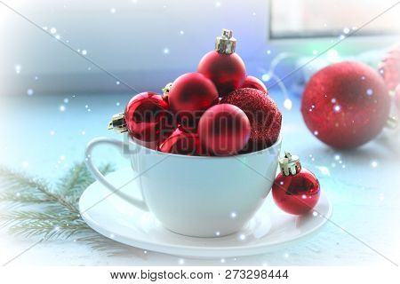 Christmas Card, New Year. Red Balls For The Christmas Tree Poured Into A White Cup . Mountain Of Red
