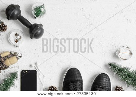 Fitness And Healthy Christmas Sport Composition. Overhead Shot Of Sport Shoes, Dumbbells, Skipping R