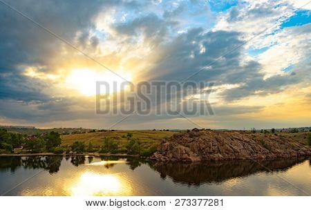 Beautiful Bright Sunset Sky over Rocky Coast. Beauty of Nature