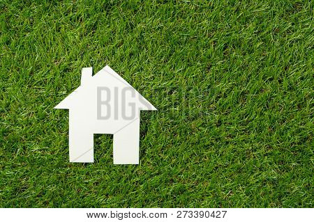 Top View White House On Green Grass In Conceptual Image Of Investment Business And Property Industry