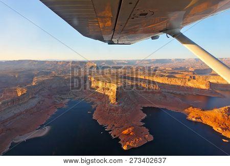 Phenomenally beautiful lake Powell photographed from the plane. A sunset
