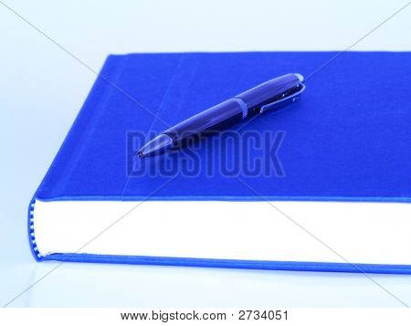 Blue Book And Pen