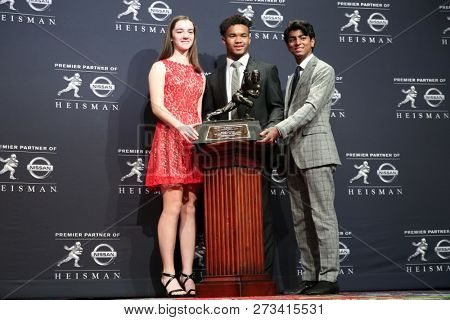 NEW YORK-DEC 8: (L-R) Lauren Eccles, Oklahoma Sooners quarterback Kyler Murray, winner of the 84th Heisman Trophy, and Sunjay Chawla on December 8, 2018 at the Marriott Marquis in New York City.