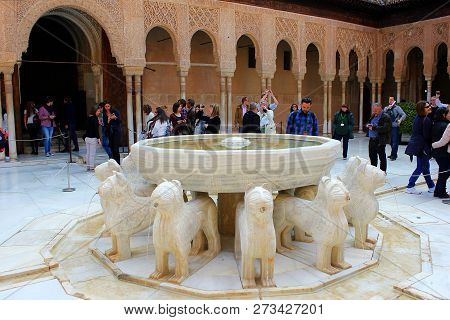 Granada, Spain - March 14, 2015: Groups Of Tourists Taking Pictures In Patio De Los Leones. Alhambra