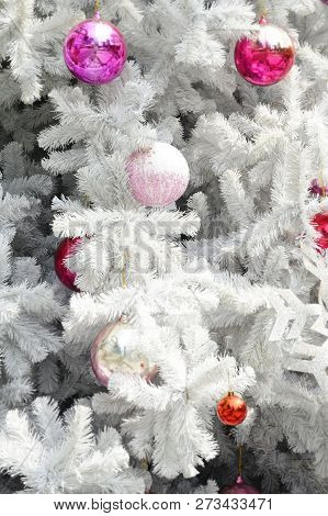 Decorated Christmas Tree With Balls On Background