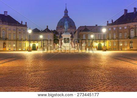 Amalienborg Palace Square and Amalienborg Palace with statue of Frederick V, Copenhagen, capital of Denmark. poster