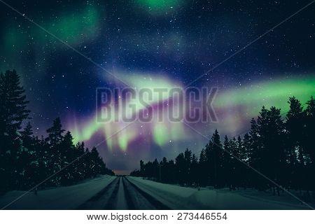 Colorful Polar Arctic Northern Lights Aurora Borealis Activity In Winter Finland