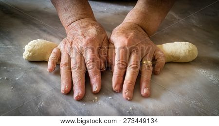 Elderly Womans Hands Kneading Dough To Make Fresh Bio Italian P