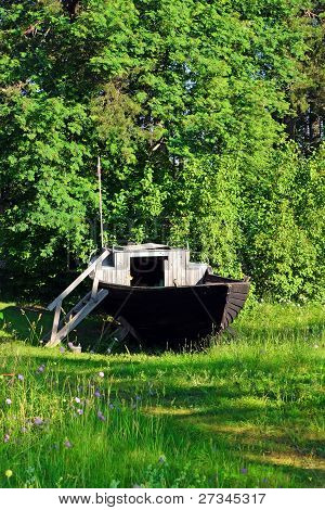 Old Wooden Boat On The Green Meadow