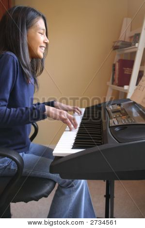Cute Hispanic Girl Playing Piano