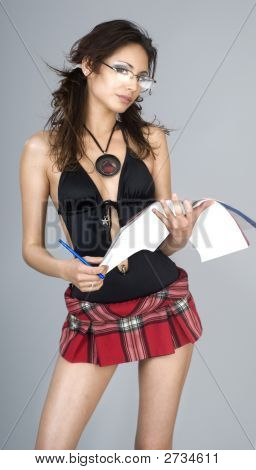 Sexy young woman in mini plaid skirt and nerdy school glasses presenting holding a generic book put your title in the space. poster