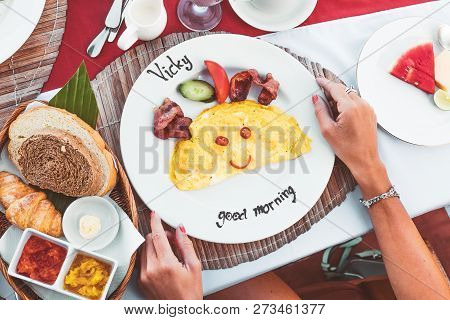 Top Up View Of Woman Hands Having Breakfast With Omlete In Restaurant. Bali Island.