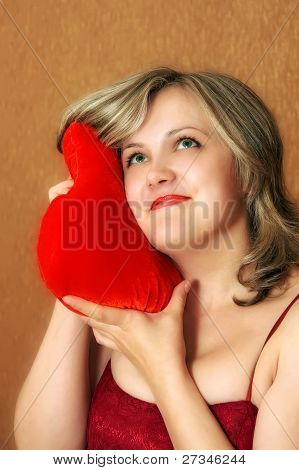 Smiling Women With A Heart Pillow
