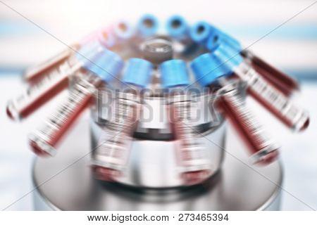 Blood test tubes in centrifuge. Medical laboratory concept. 3d illustration
