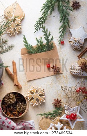New Year And Christmas Background. Christmas Candy Cane Gingerbread On Light Background. New Year An
