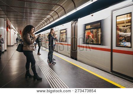 Vienna, Austria - November 25, 2018: People Standing On The Underground Platform In Vienna, Train Ar