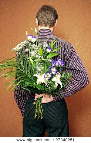Rear View Of Man With Flowers