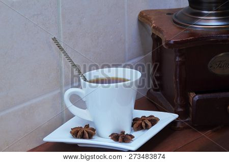 White Exclusive Porcelain Pair With Strong Coffee, Star Anise And Rare Coffee Grinder On Wooden Brow