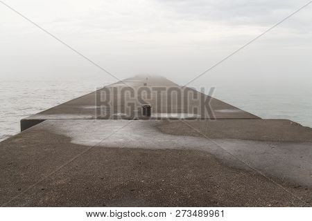 A Concrete Pier On A Foggy Lake.  Sheboygan, Wisconsin, Usa.