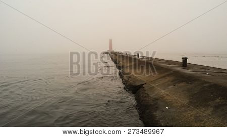 A Lighthouse Pier On A Foggy Lake.  Sheboygan, Wisconsin, Usa.